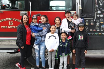 group picture in front of fire engine