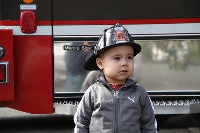 kid in front of fire engine
