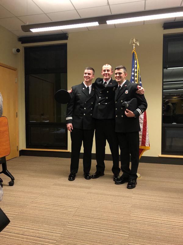 3 firefighters in dress uniform pose for photo