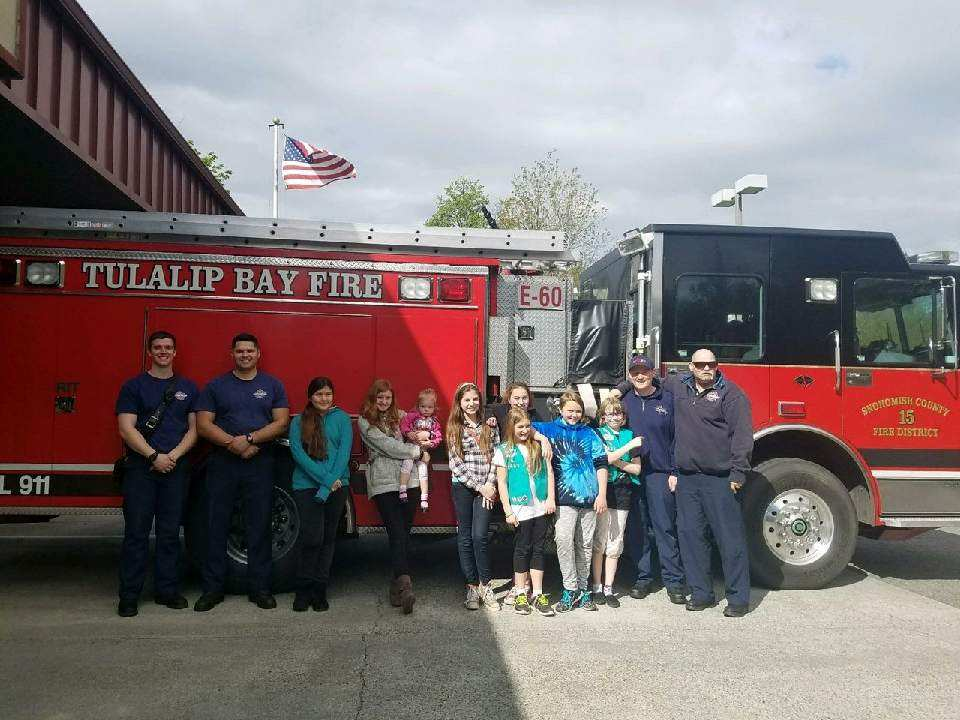 fire fighters and community members in front of engine