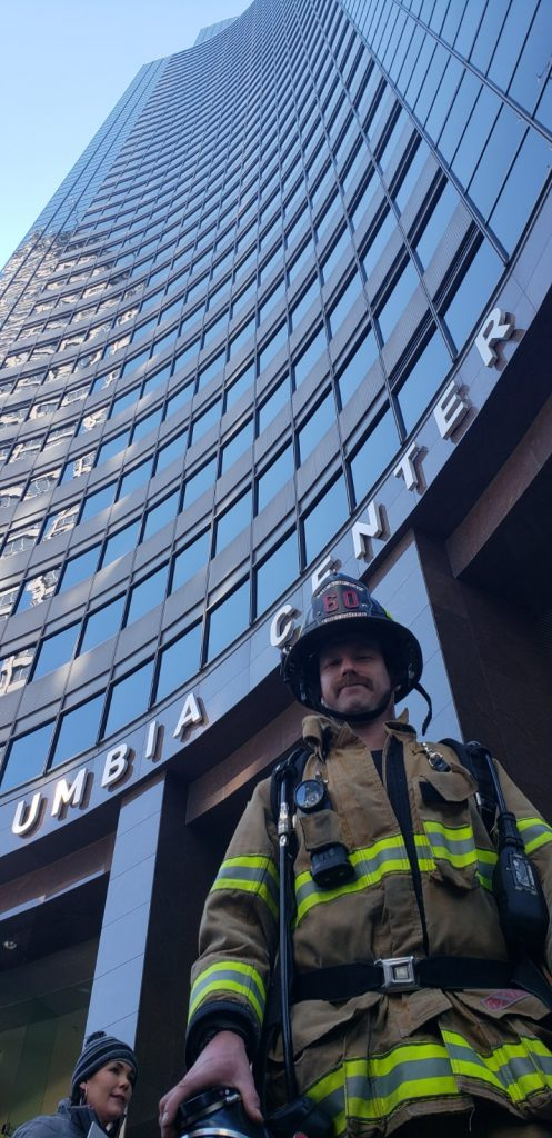 fire fighter in front of building