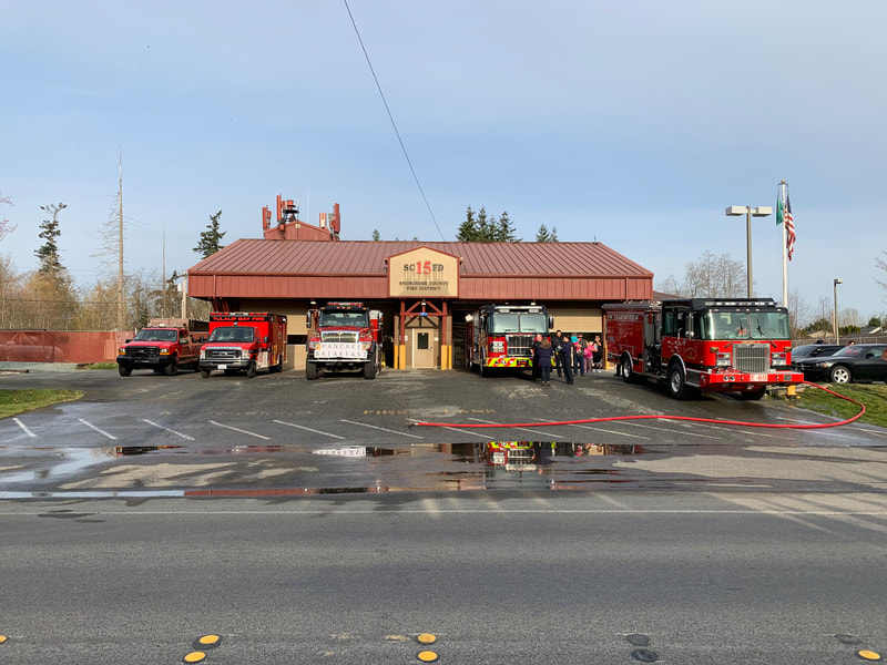 fire house with apparatus out front