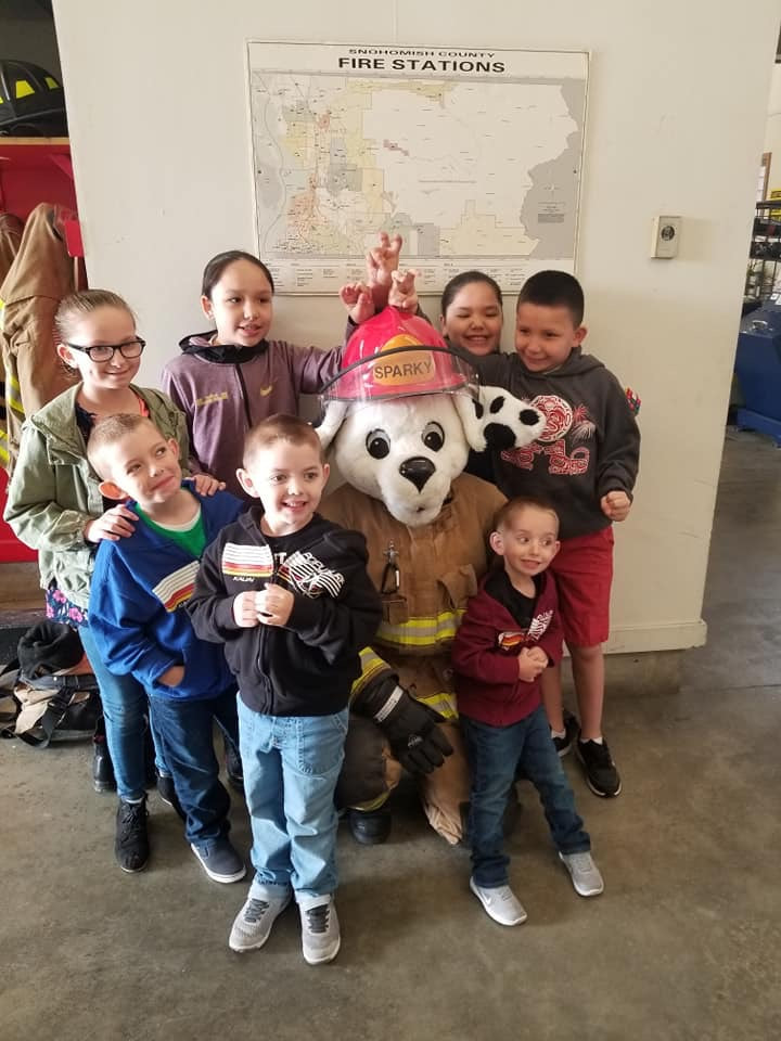 group of kids with sparky the mascot