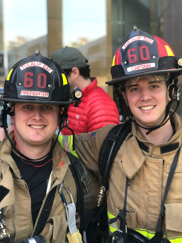 two firefighters smiling